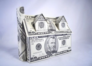 Bigstock-A-house-made-of-money-dollars-13751546